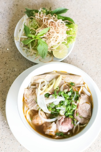 Bún Bò Huế served with delicious herbs